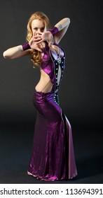 Beautiful woman is dancing the oriental dance