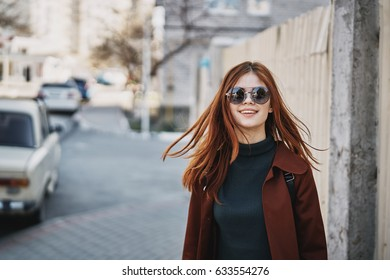 Beautiful woman in dark glasses on the street