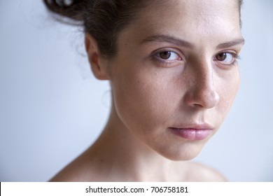 Beautiful Woman with Dark Hair and Big Eyes Portrait