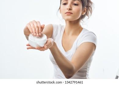 beautiful woman dark hair jar with skin care cream