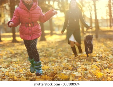 A beautiful woman and daughter and his dog Cane corso posing outside in autumn park. Concept blur