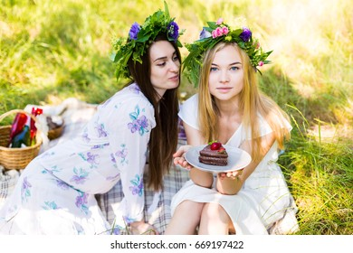 Beautiful woman with a desert having a summer picnic