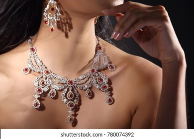 Beautiful Woman with Diamond Bib Necklace for Christmas Holiday Gift surprise, Lady neck for jewelry Gems, dark background copy space