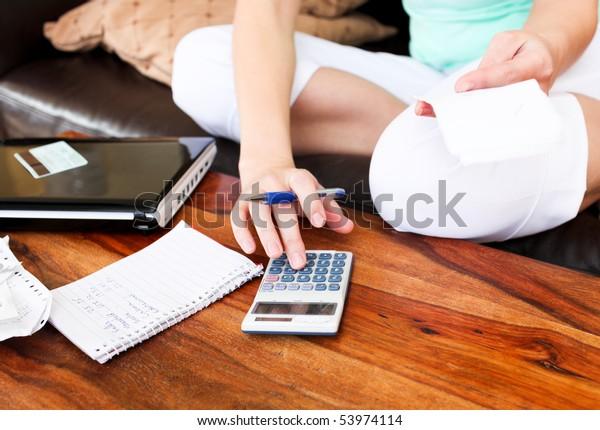 Beautiful woman doing accountancy at home