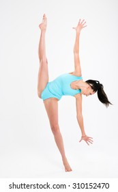 Beautiful woman doing acrobatic stunt isolated on a white background