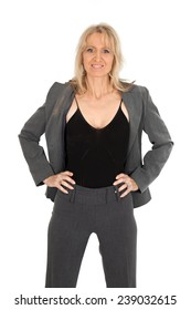 Beautiful woman doing different expressions in different sets of clothes: hands on hips