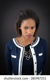 Beautiful woman doing different expressions in different sets of clothes: sad