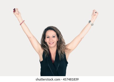 Beautiful woman doing different expressions in different sets of clothes arms raised