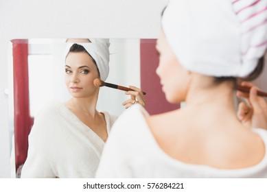 Beautiful woman doing make up