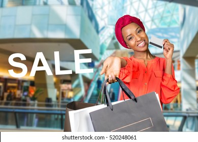 Beautiful woman doing shopping and holding bags