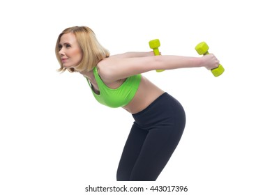Beautiful woman doing sport exercise with dumbbells