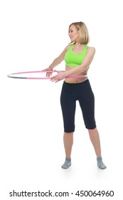 Beautiful woman doing sport exercise with hula hoop