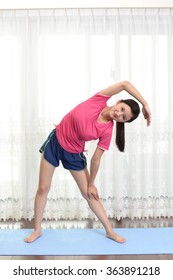 Beautiful woman doing stretch