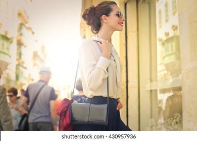 Beautiful woman doing window shopping
