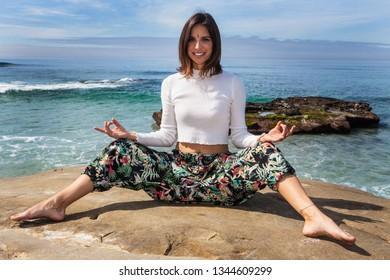 beautiful woman doing yoga by the ocean in la jolla, california