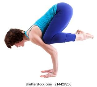 Beautiful woman doing yoga. Isolated on white