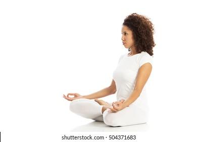 Beautiful woman doing yoga, isolated on white