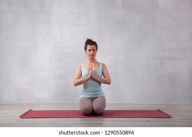 Beautiful woman doing yoga. Lotus pose. Meditation