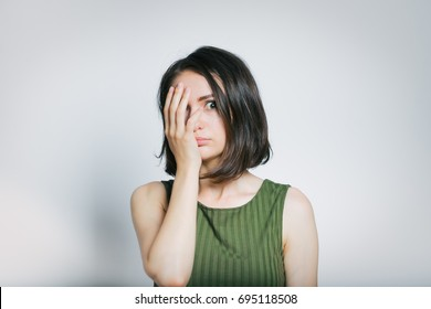 beautiful woman done mistake, isolated on a gray background