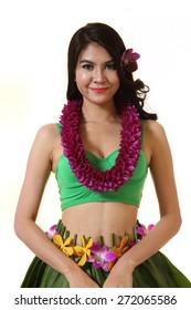 Beautiful woman dress in Hawaiian style with flower lei garland of orchids on white background.