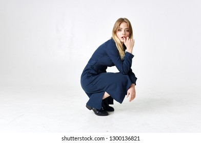 beautiful woman in dress sitting studio fashion