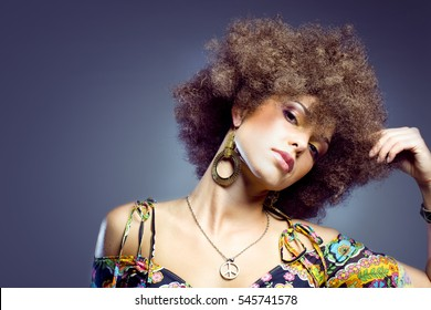Beautiful woman dressed in 1970's styled clothing.