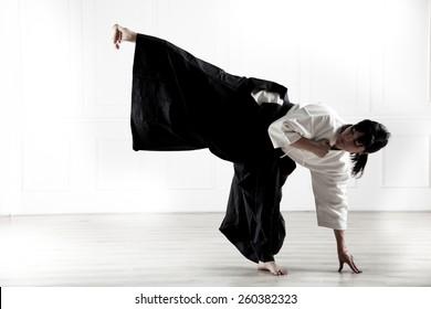beautiful woman dressed in a hakama, practicing  kung fu