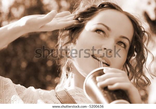 beautiful woman drink water - nature background