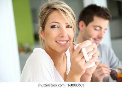 Beautiful woman drinking coffee at breakfast time