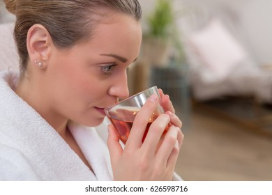 beautiful woman drinking tea in relaxation room