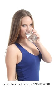 Beautiful woman drinking water from a glass on a white isolated background