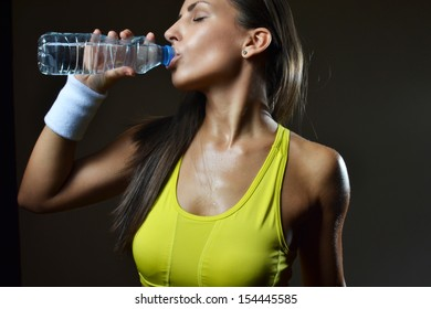 beautiful woman drinking water, studio shot