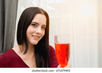 Beautiful woman drinking wine in a restaurant.
