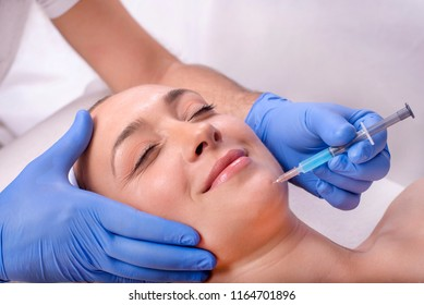 Beautiful woman during anti aging treatment with hyaluronic acid