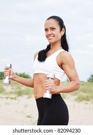 beautiful woman during fitness on sea beach
