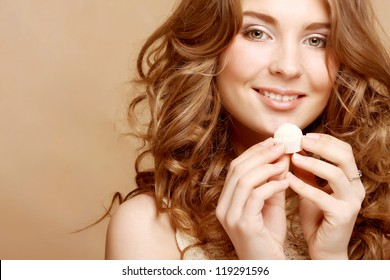 Beautiful woman eating candy
