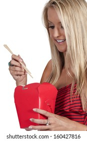 Beautiful woman eating Chinese Japanese or Asian takeout food