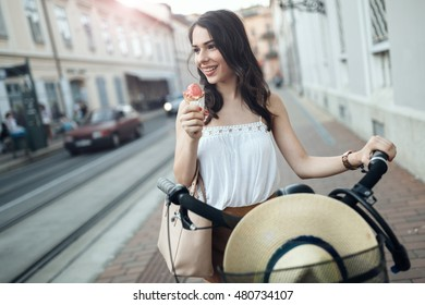 Beautiful woman eating ice cream outdoors