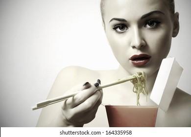 beautiful woman are eating.red lips.Chinese sticks.food menu