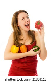 beautiful woman eating peppers isolated against white background