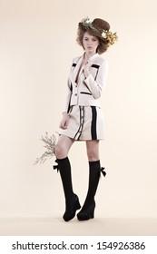 Beautiful woman elegance dress fashion posing with flowers decoration.- studio shot