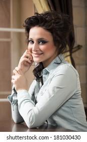 Beautiful woman with elegant hairstyle. Fashion photo