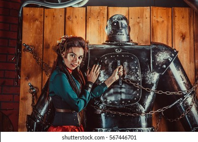 A beautiful woman embracing male robot with love. Relationship between artificial cyborg and real girl. Portrait of futuristic couple.