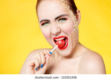 Beautiful woman with emotions and lollipop