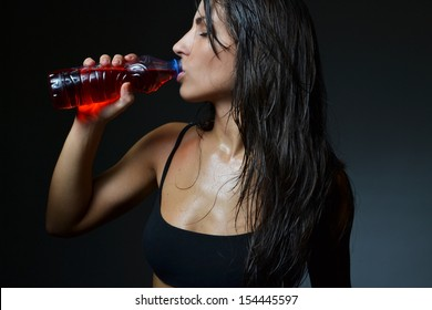 beautiful woman with energy drink, studio shot