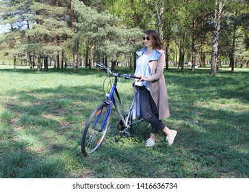 A beautiful woman or Enjoy life. Happy moments. I like my bike. Vacation.