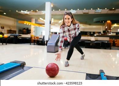 Beautiful woman enjoying  bowling