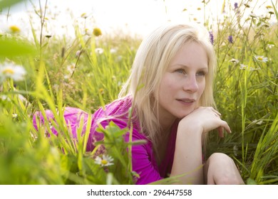 A Beautiful woman enjoying daisy in a field