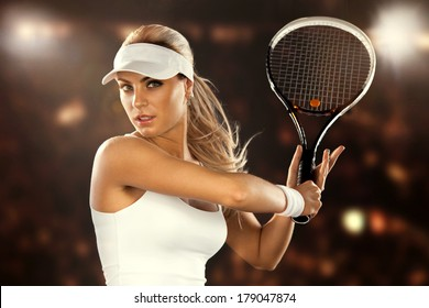 Beautiful woman enjoying the great game of tennis. Playing tennis