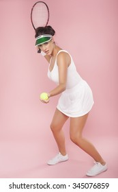 A beautiful woman enjoying the great game of tennis over a pink background. Playing tennis.